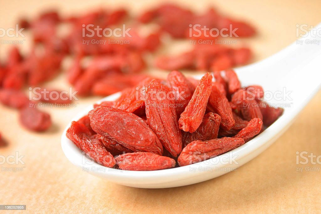 Dried goji berries on spoon royalty-free stock photo