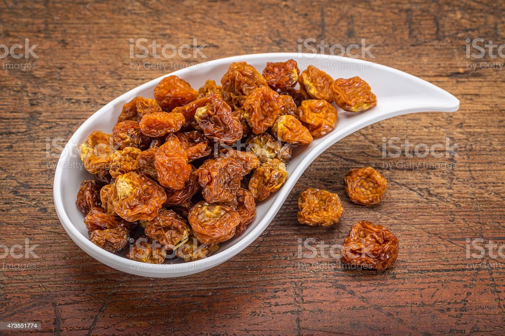 dried goldenberries in bowl stock photo