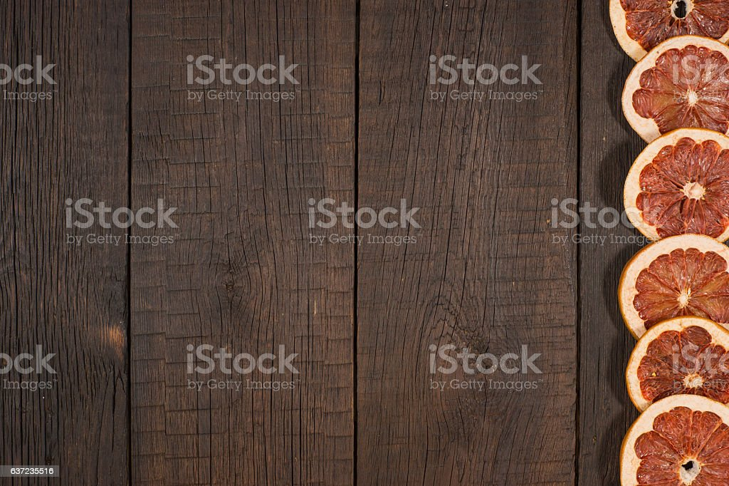 Dried  grapefruits in the old dark wood table. stock photo