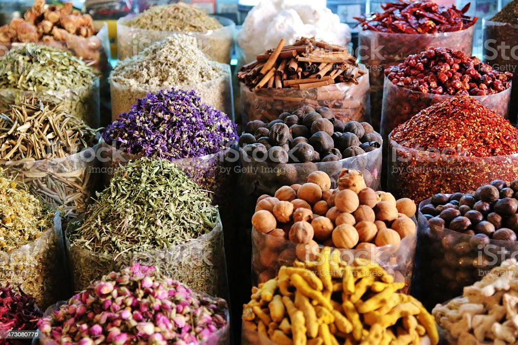 dried herbs flowers spices in the spice souq at Deira stock photo