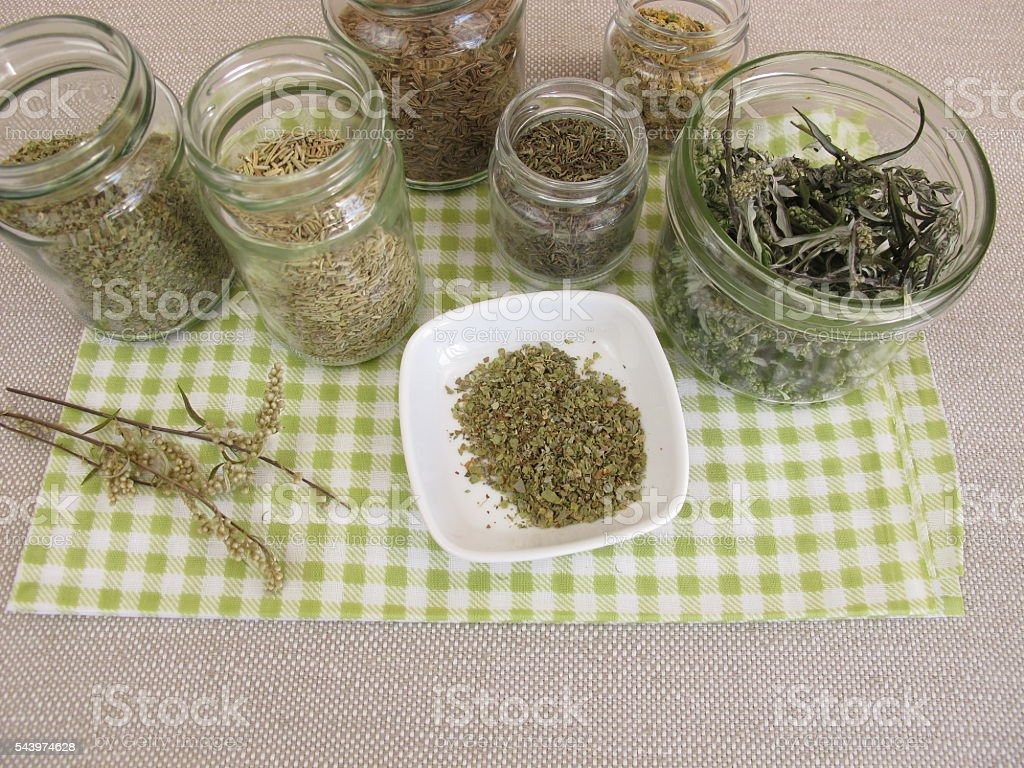 Dried herbs in jars stock photo