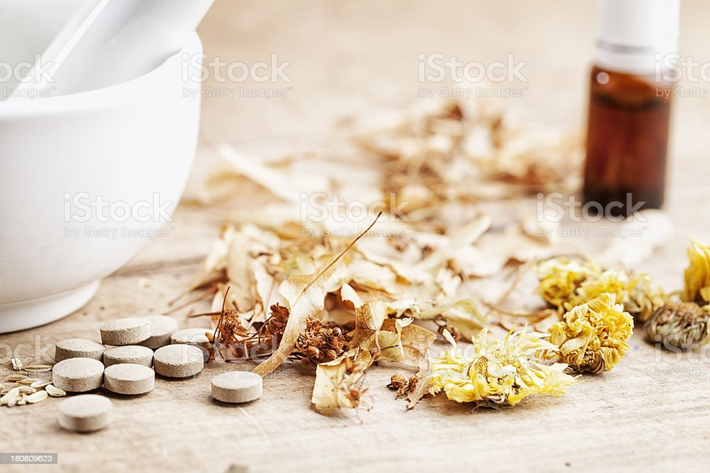 dried herbs, pills alternativer medicine stock photo