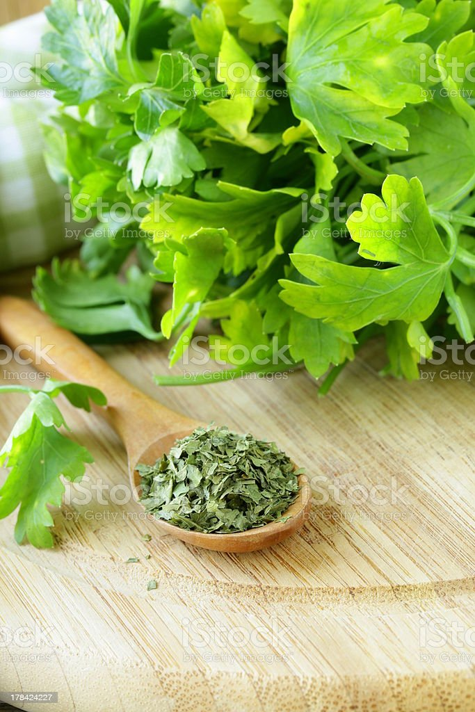 dried herbs spices in wooden spoon royalty-free stock photo