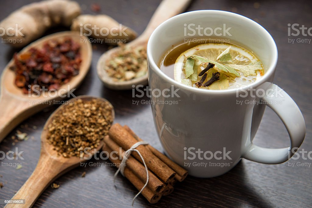 Dried Herbs With Cup Of Herbal Tea stock photo