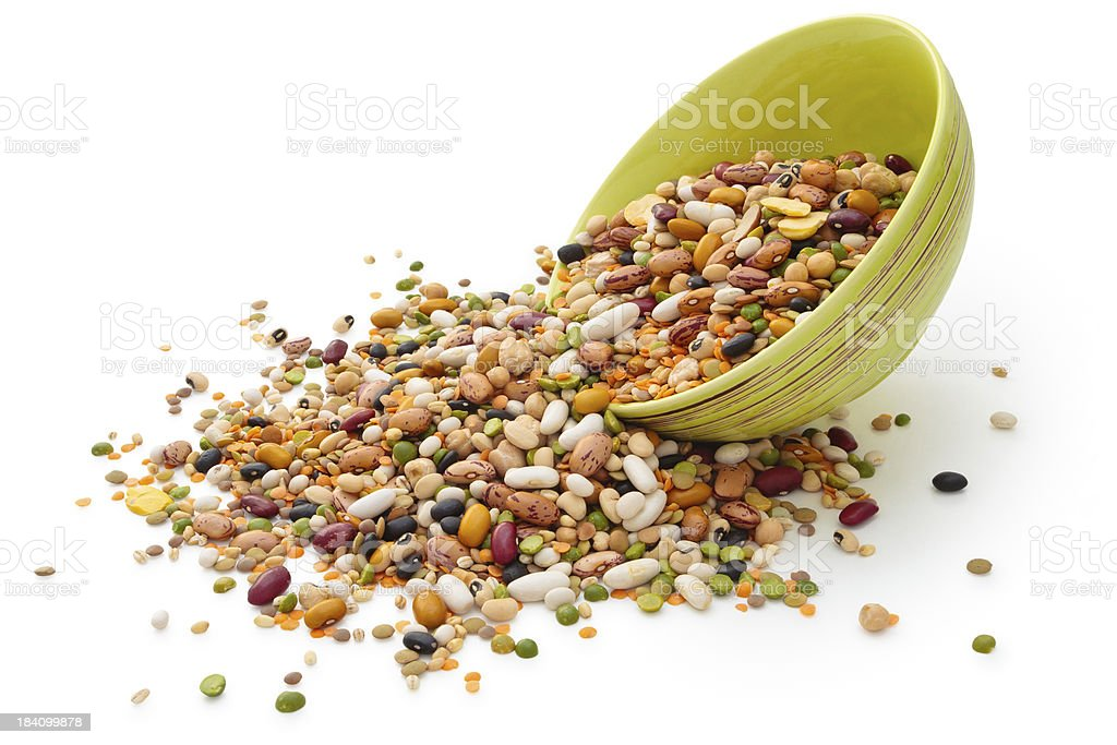 Dried legumes and cereals in green bowl royalty-free stock photo