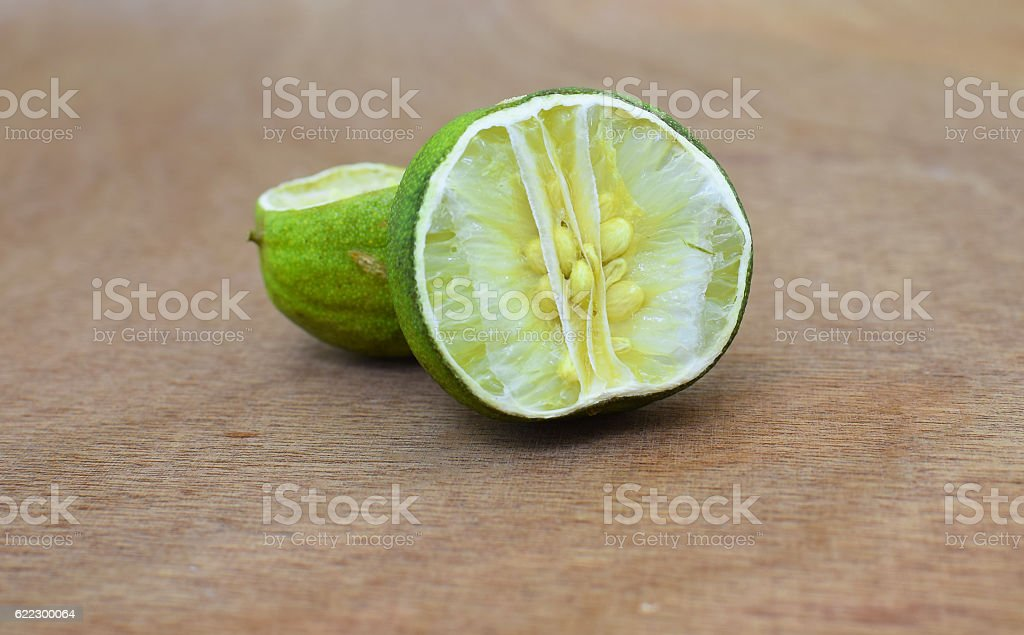 Dried lime / lemon on wooden background stock photo