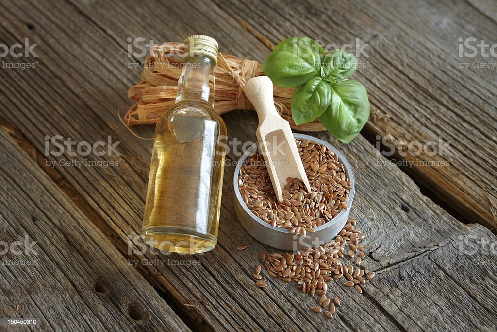 Dried linseed with macerated oil stock photo