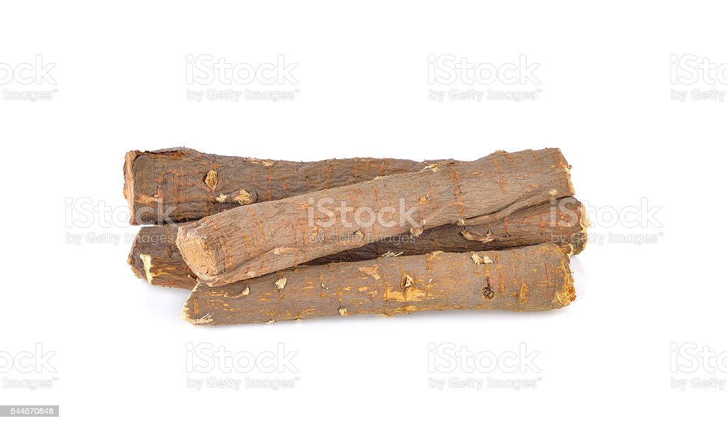dried Liquorice roots isolated on a white background stock photo