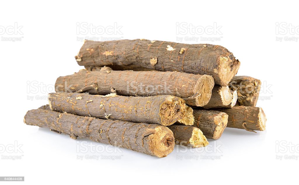 dried Liquorice roots isolated on white background stock photo