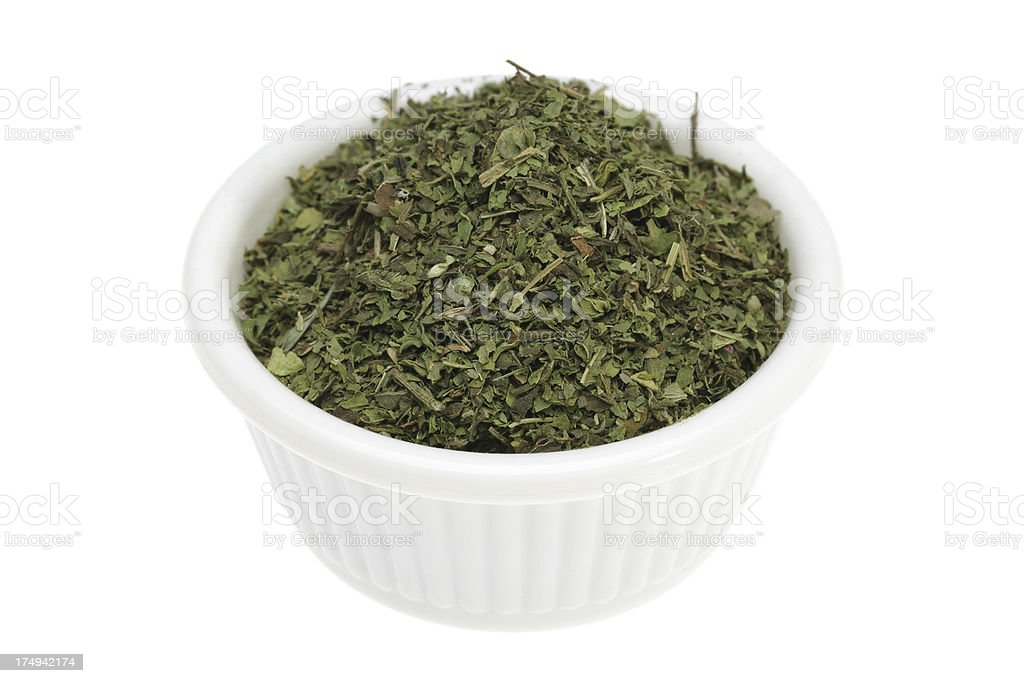 Dried mint in a small white bowl royalty-free stock photo