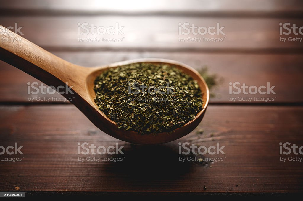 Dried mint in wooden spoon stock photo