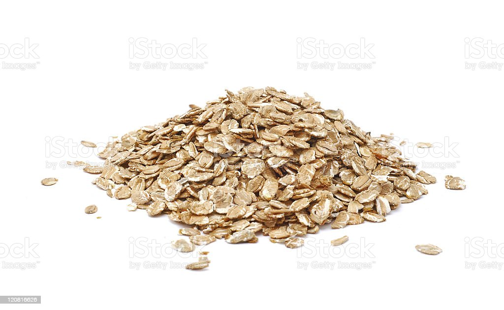 Dried oatmeal in a pile isolated on a white background stock photo