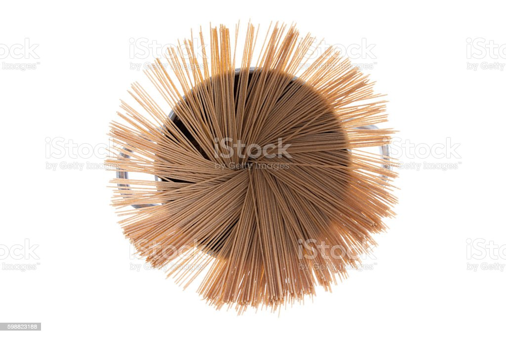 Dried organic spaghetti fanned in a pot stock photo