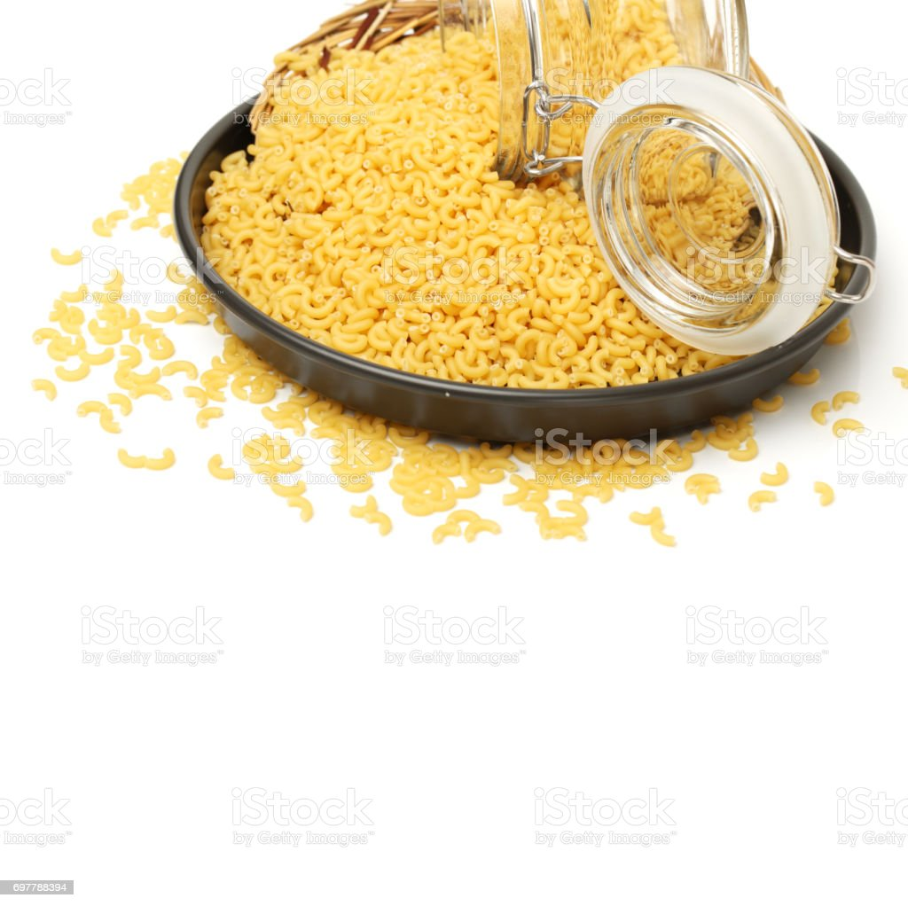 Dried pasta and elbow pasta, close-up of white background stock photo