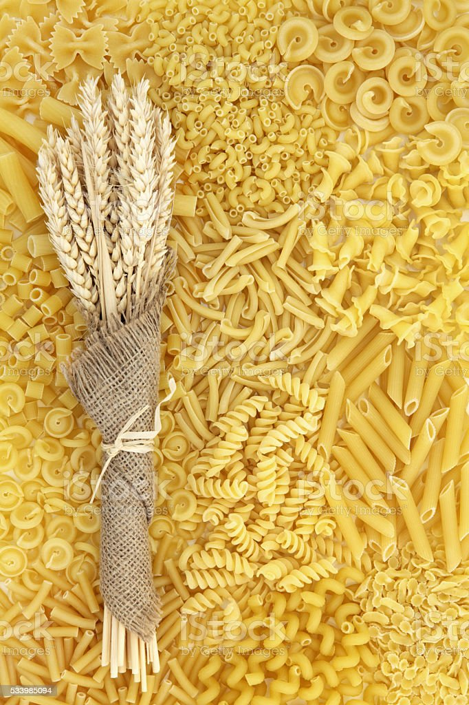 Dried Pasta and Wheat Background stock photo