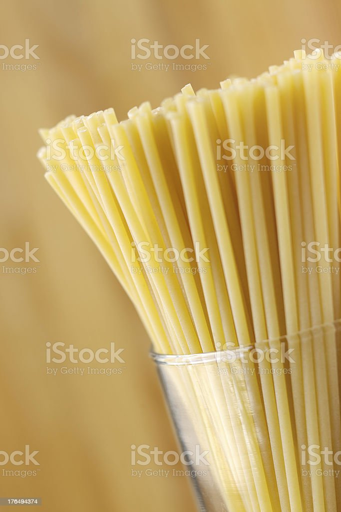 Dried pasta in glass cylinder bowl royalty-free stock photo