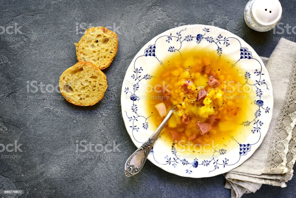 Dried pea soup with smoked bacon stock photo