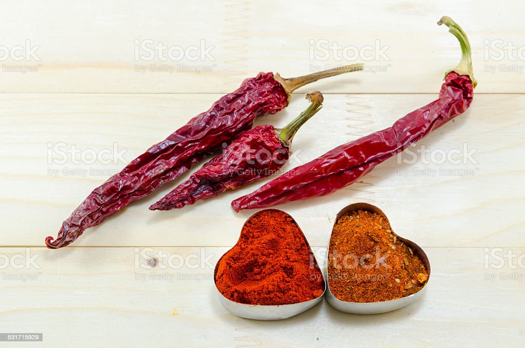 Dried peppers and spices on a table royalty-free stock photo