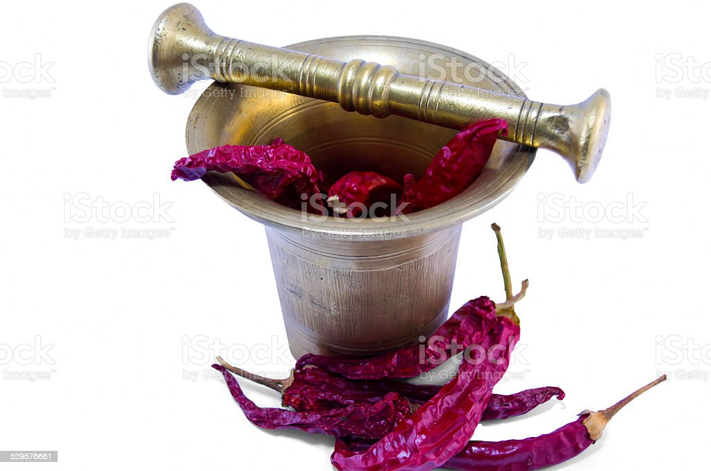 Dried peppers in an old-fashioned mortar royalty-free stock photo