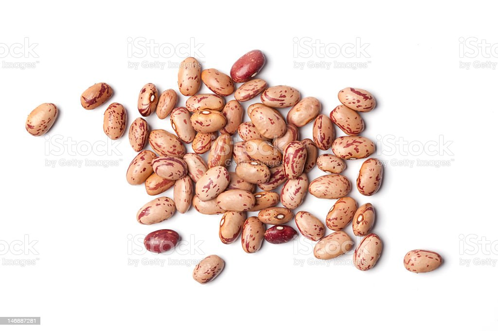 Dried pinto beans in a pile on a white background stock photo