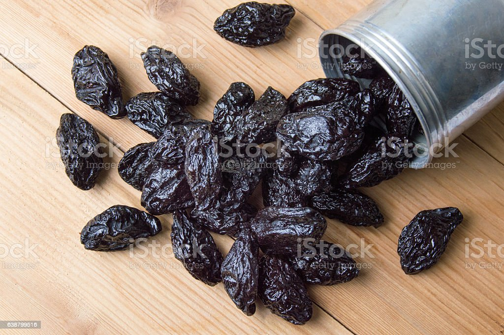 Dried plums in metal can stock photo