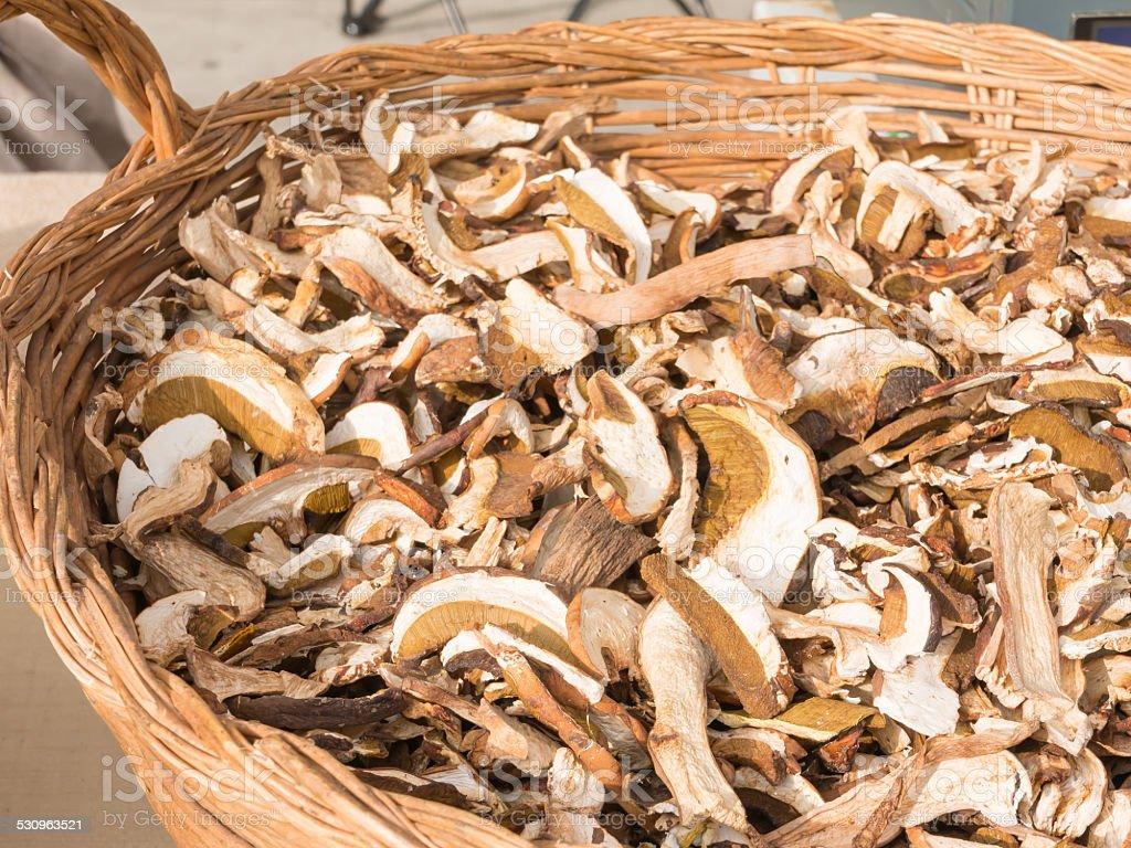 dried porcini mushrooms in wicker bowl stock photo