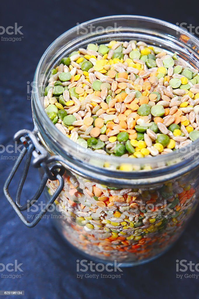 Dried pulses in a jar. stock photo