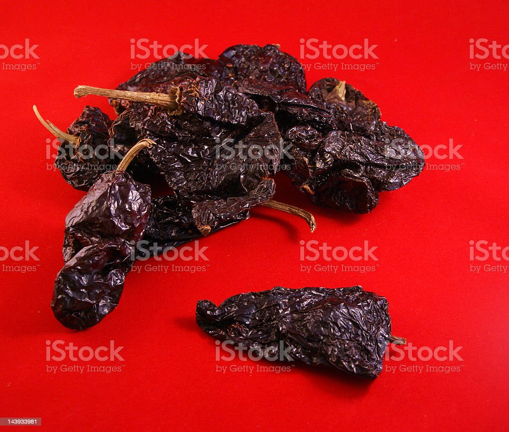 Dried red ancho chiles stock photo