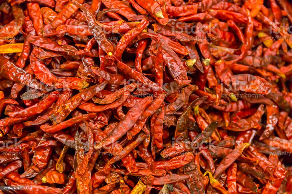 Dried red chille peppers background stock photo