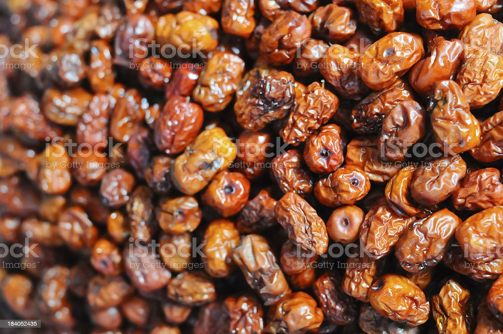 Dried red date stacked in the market place royalty-free stock photo