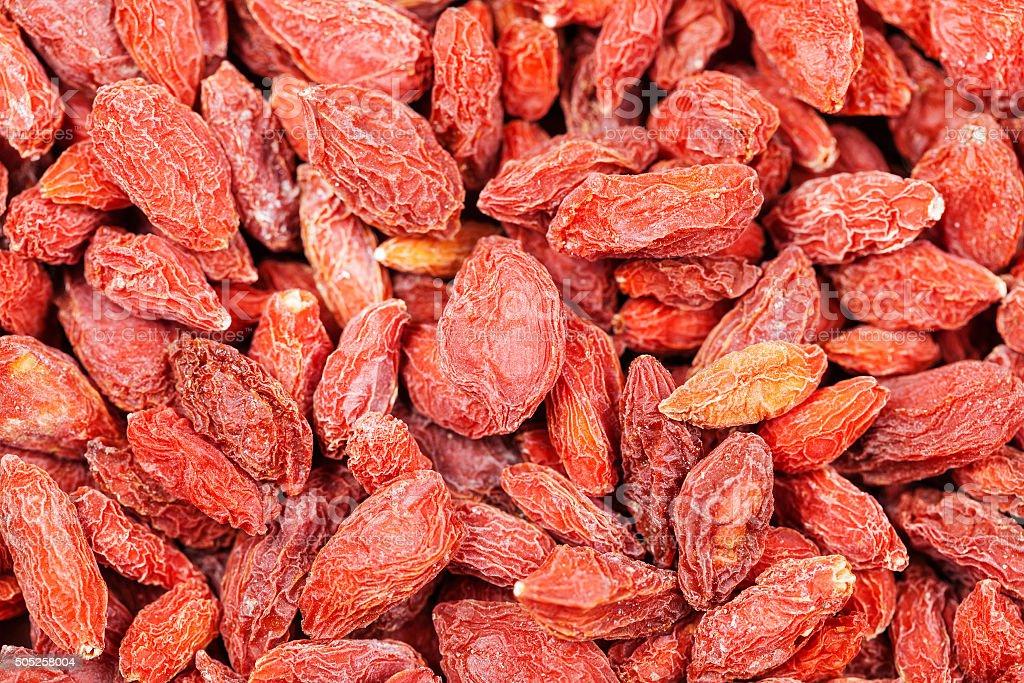 dried red goji berries close up stock photo