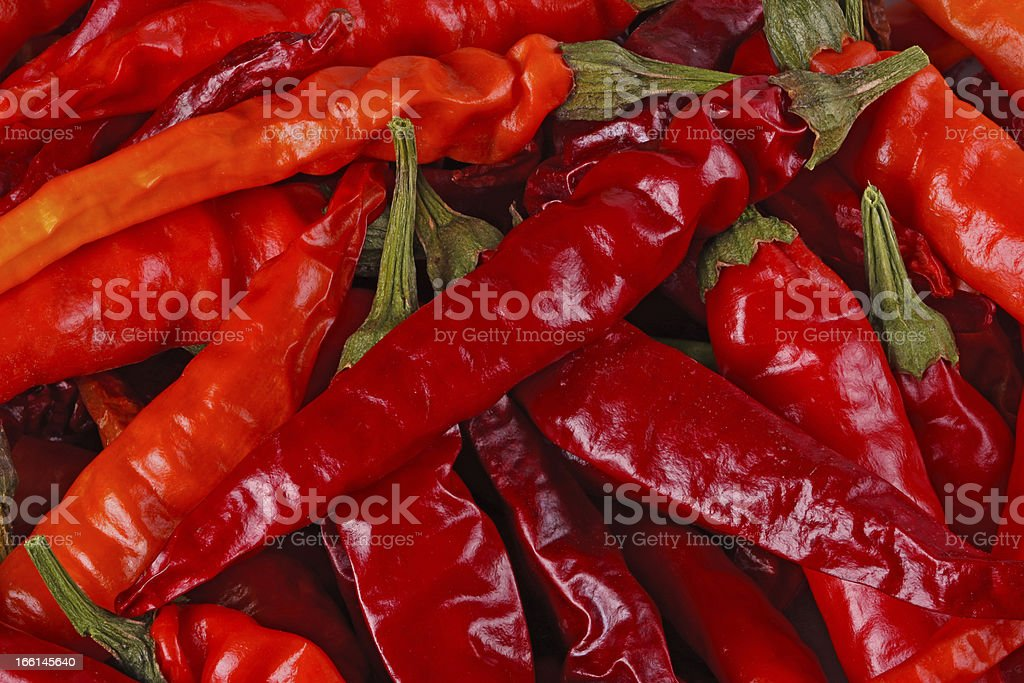 Dried red hot chili peppers fill the frame royalty-free stock photo