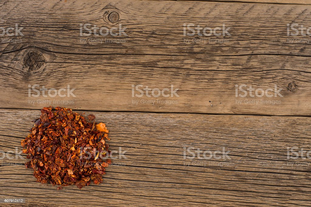 Dried red pepper on old wooden table. stock photo