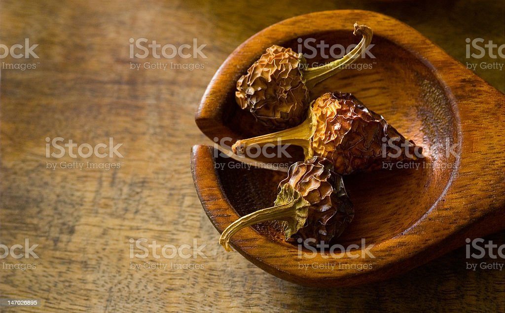 Dried red peppers on cutting board royalty-free stock photo