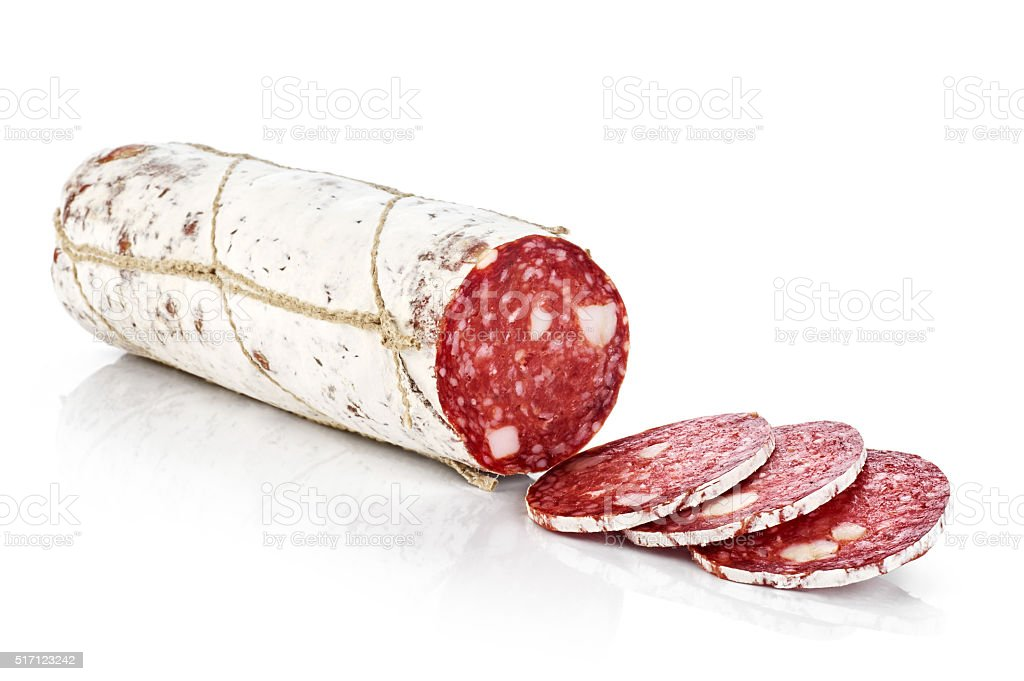 Dried salami with white mold isolated on white background. stock photo