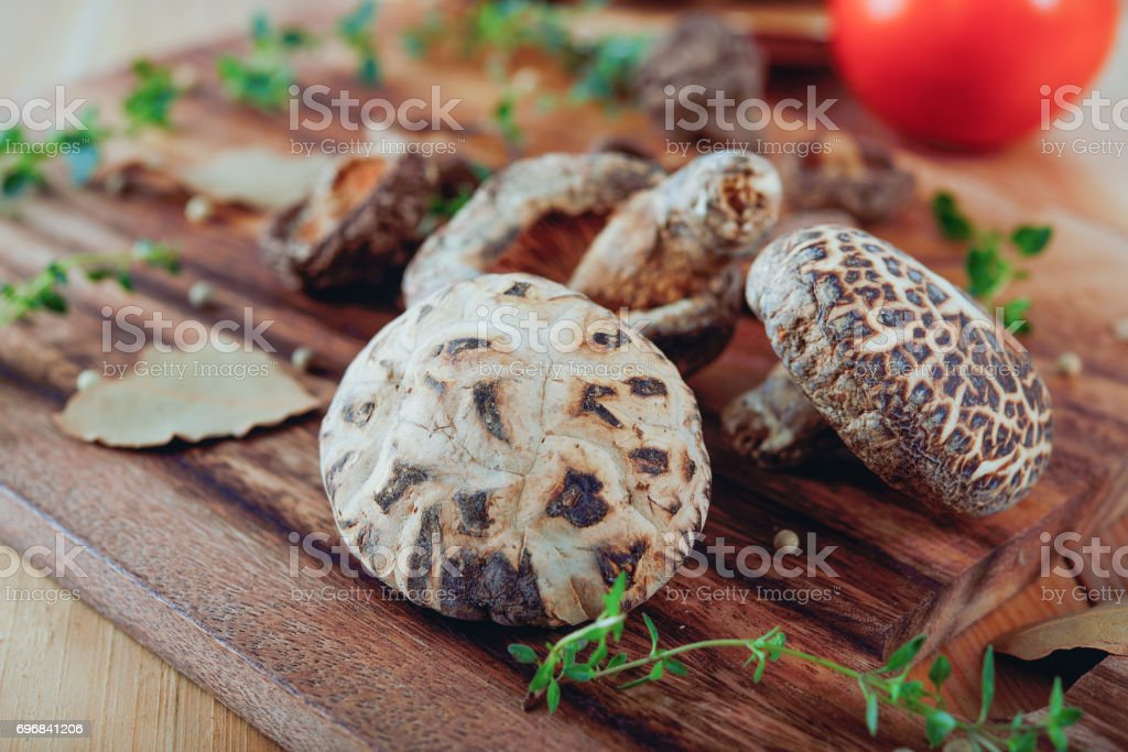 dried shiitake mushroom on wooden board stock photo