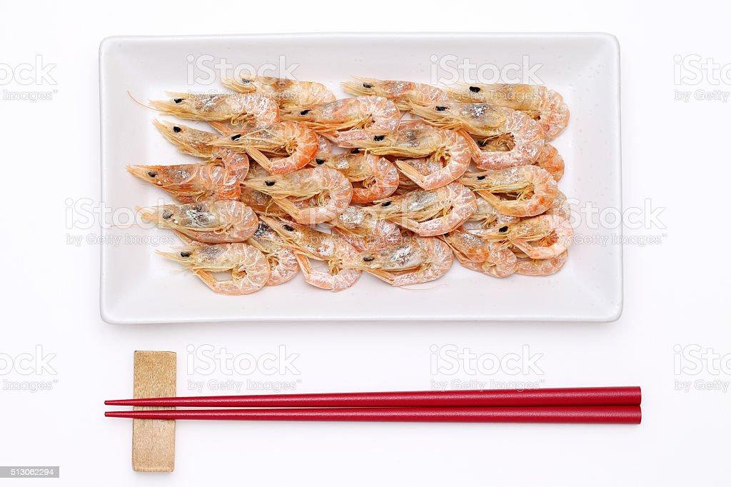 dried shrimp with chopsticks stock photo