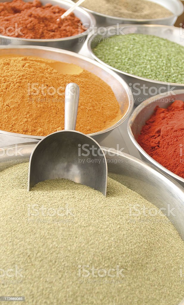 Dried spices in bowls with large scoop royalty-free stock photo