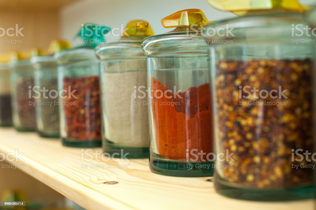 Dried spices in glass jars stock photo