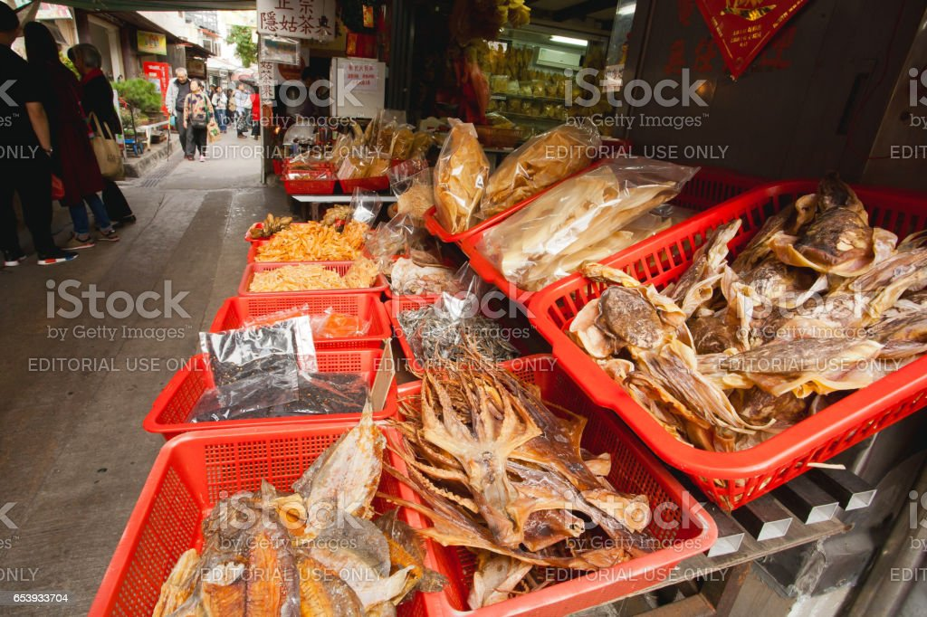 Dried squid and other seafood delicacies of market street stock photo