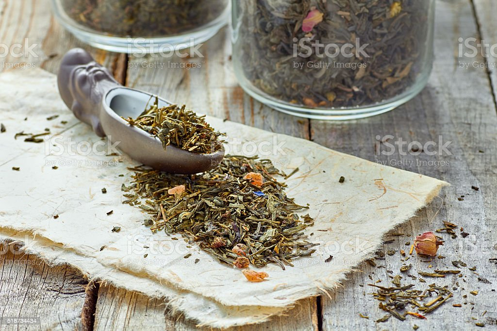 Dried tea leaves with ceramic showel stock photo