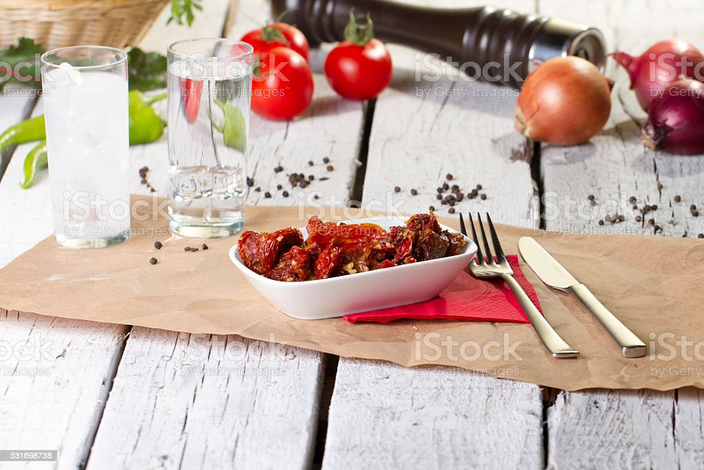 dried tomatoes in a bowl with raki stock photo