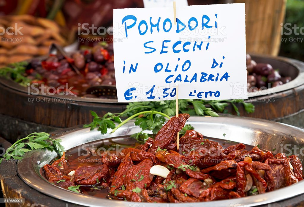 Dried tomatoes on market stall stock photo