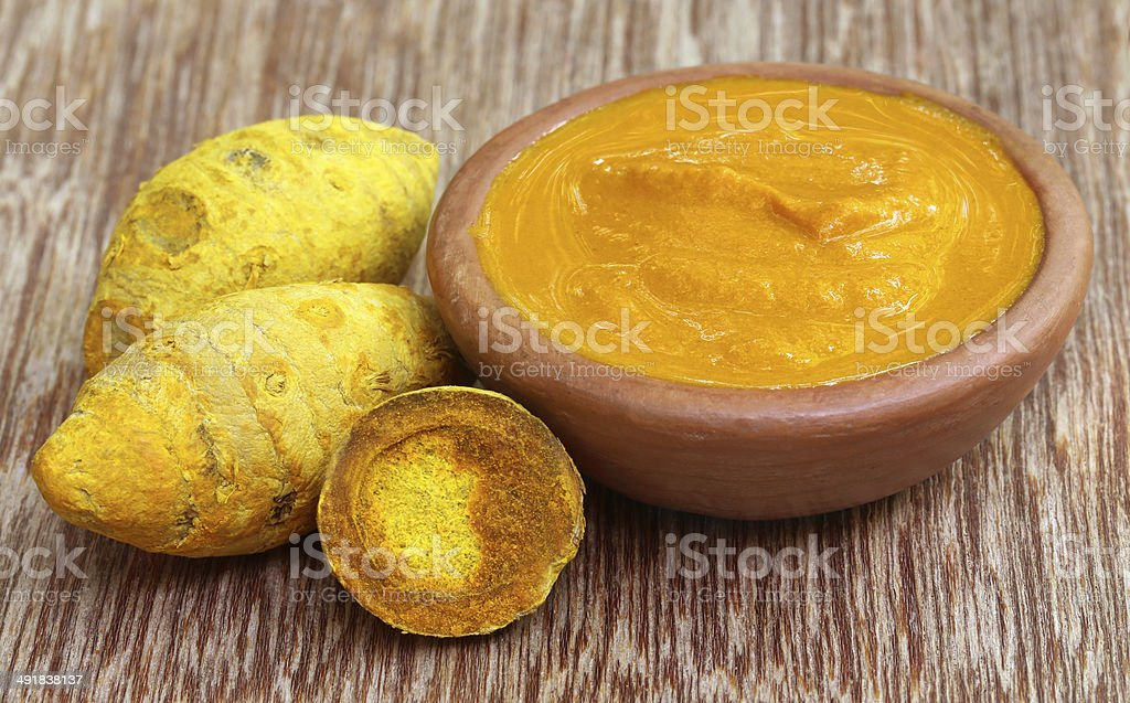 Dried turmeric with paste stock photo