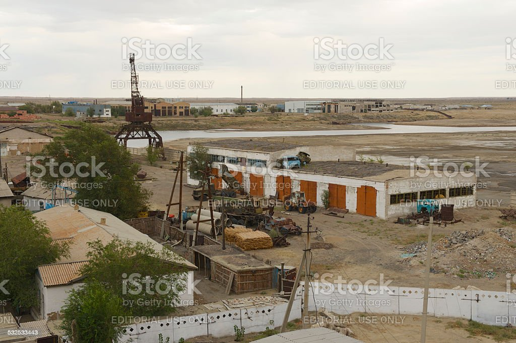 Dried up port at Aral sea shore in Aralsk, Kazakhstan. stock photo