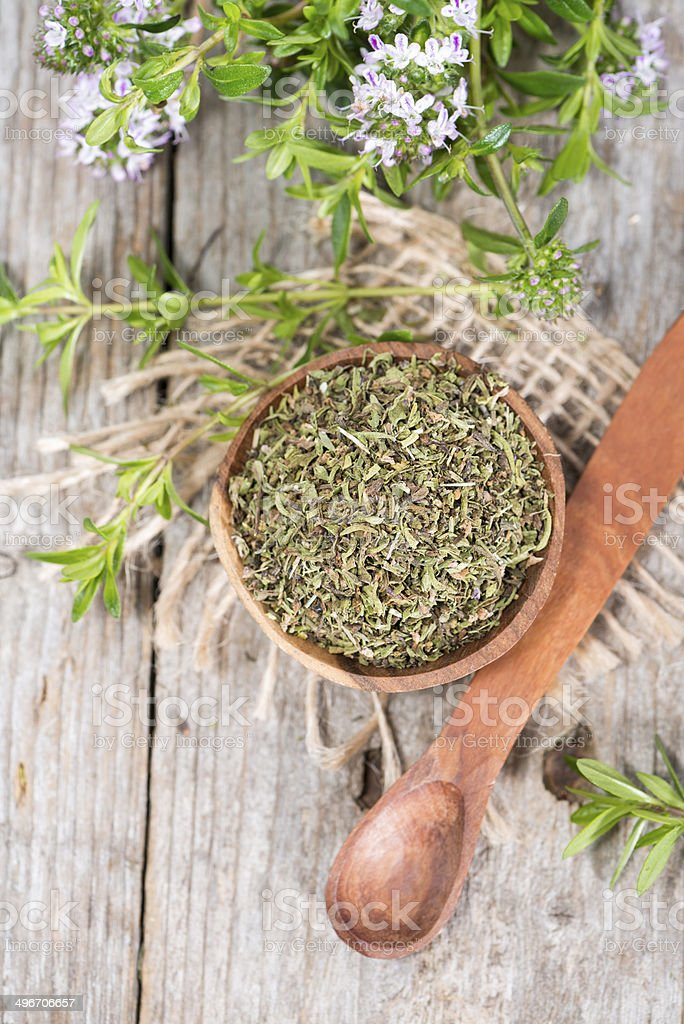 Dried Winter Savory in a bowl stock photo