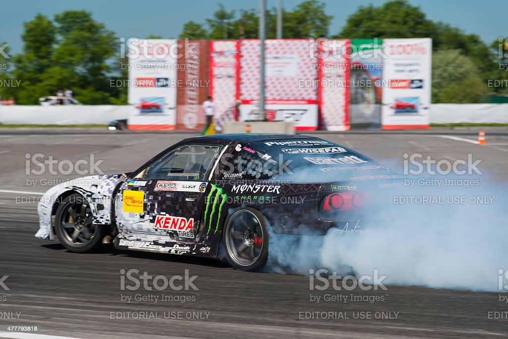 Rider Dmytro ILLYUK on the car brand Nissan overcomes the track in...