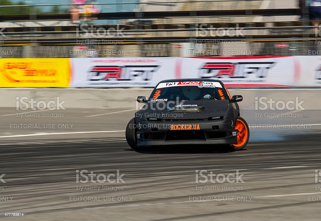 Unknown rider on the car brand Nissan overcomes the track in the...