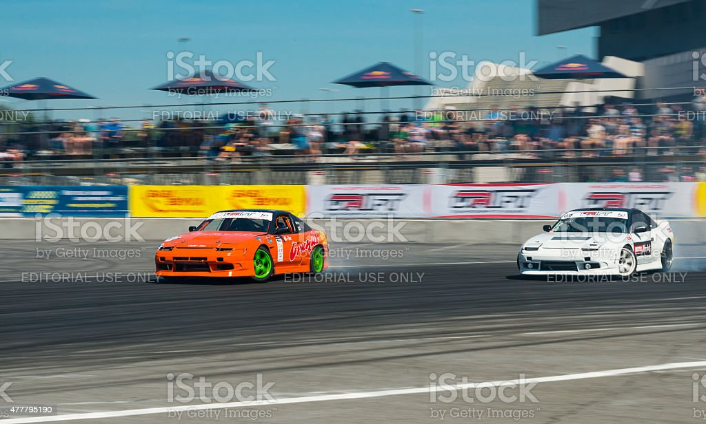 Unknown riders on the car brand Nissan overcomes the track in the...