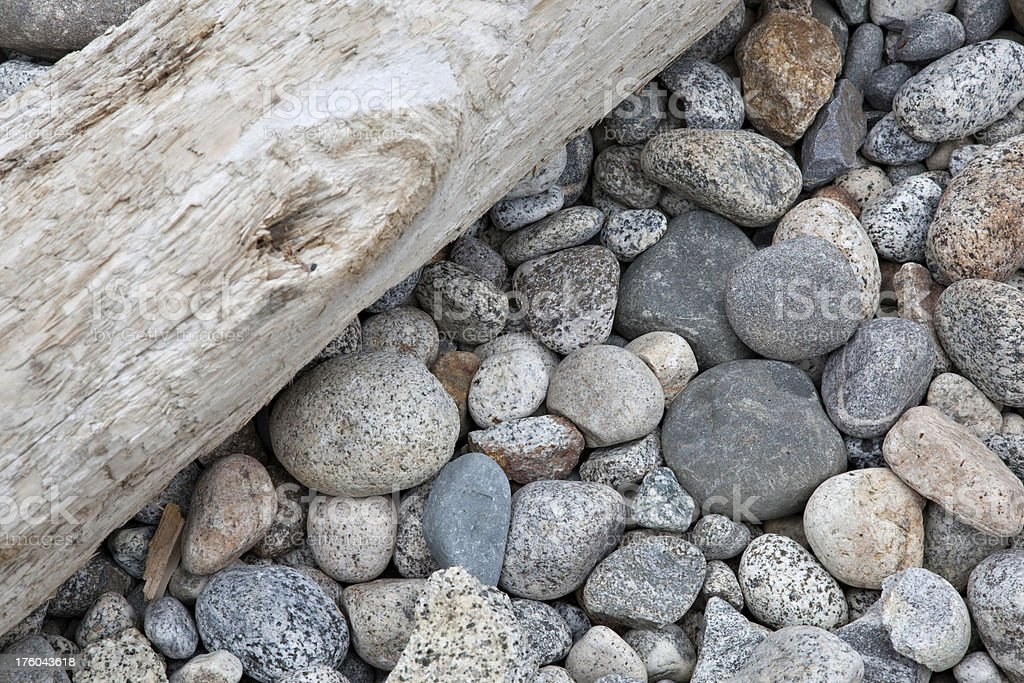 Driftwood and Dry River Rocks royalty-free stock photo